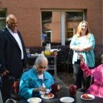 Hamilton Holmes, Jr., visits with residents