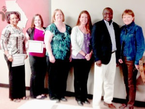 Peer Coaching session with staff from high-quality nursing homes, including A.G. Rhodes of Atlanta.
