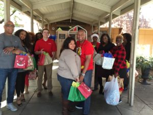 Employees at First Investors Financial Services delivered gifts and visited residents