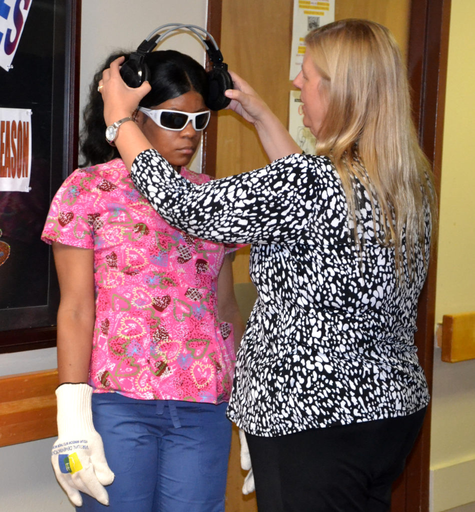 Staff from Second Wind Dreams began taking A.G. Rhodes employees through the Virtual Dementia Tour, to help them understand what dementia might feel like.